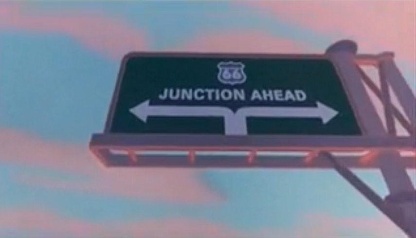 """A sign that reads, """"Route 66 Junction Ahead""""."""
